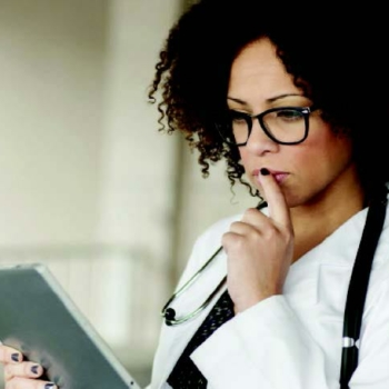 Woman holding tablet using clinical analysis software