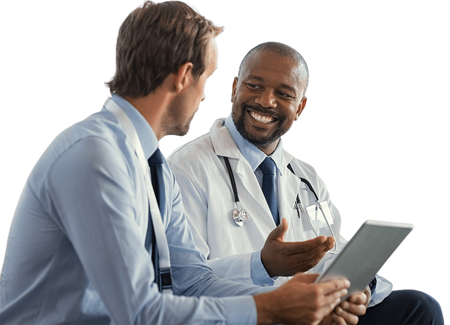 Doctor and data abstractor looking at medical software and smiling at each other